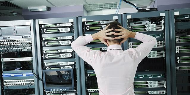 it business man in network server room have problems and looking for  disaster situation  solution-591452-edited.jpeg